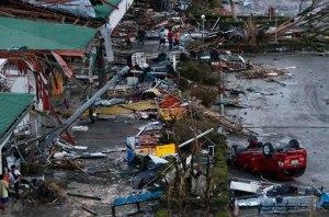 Debris litter damaged airport after super Typhoon Haiyan battered Tacloban